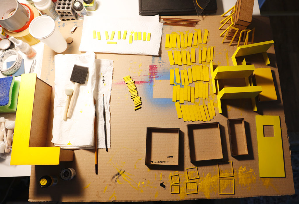 Behind the Scenes of Yellow Cube: Painting the Furniture